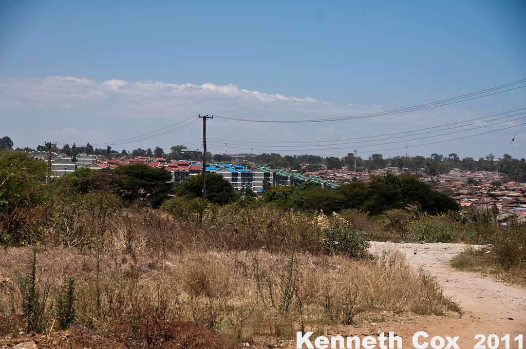 More of the Kibera slum. The new buildings to the left are housing projects built by Habitat for Humanity. The hope to clear out the slums by 2030.