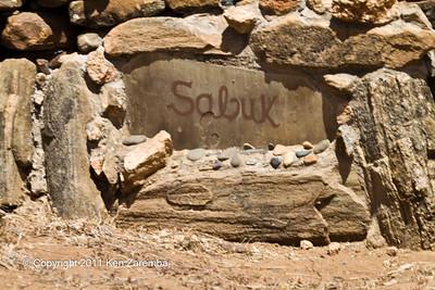 Sabuk Safari Lodge sign at the  main road turn off
