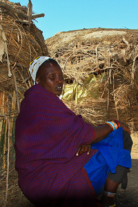 Maasai wife waits outside while we vist her home, Tanzania 1/03/09