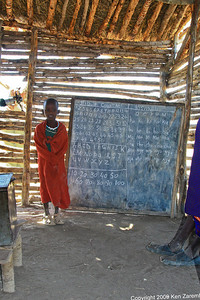 Maasai child demonstrating mastery of numbers and the English alphabet, Tanzania1/03/09