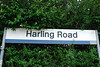 """Harling Road station sign and it still retains the now long gone regional <br /> <br /> Railways stripe logos on the right end of the sign  <br /> <br /> History of Regional Railways below <br /> <br /> <a href=""""https://en.wikipedia.org/wiki/Regional_Railways"""">https://en.wikipedia.org/wiki/Regional_Railways</a>"""