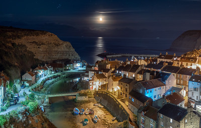 Staithes Harbor at night with moonrise