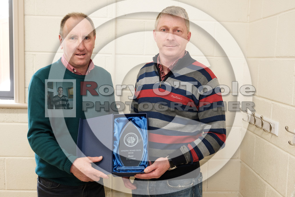 Jim Wall presents Laurence O'Connell of  Glaunthaun his prize for best tractor at the Ballinrostig Vintage Club run. Picture: Rory O'Toole