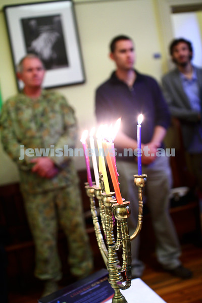 5-12-13. Last day of Chanukah. East Melbourne Hebrew Congregation. Rabbi David Gutnick, Jewish Chaplain with the Australian Defense Force, organised a candle lighting ceremony incorporating members of the ADF and guests that included Felix and Yvonne Sher, parents of Private Greg Sher who was killed in Afganistran.  Photo: Peter Haskin