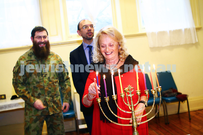 5-12-13. Last day of Chanukah. East Melbourne Hebrew Congregation. Rabbi David Gutnick, Jewish Chaplain with the Australian Defense Force, organised a candle lighting ceremony incorporating members of the ADF and guests that included Felix and Yvonne Sher, parents of Private Greg Sher who was killed in Afganistran.  Helen Brustman. Photo: Peter Haskin