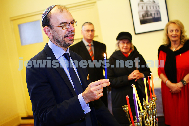 5-12-13. Last day of Chanukah. East Melbourne Hebrew Congregation. Rabbi David Gutnick, Jewish Chaplain with the Australian Defense Force, organised a candle lighting ceremony incorporating members of the ADF and guests that included Felix and Yvonne Sher, parents of Private Greg Sher who was killed in Afganistran.  Rabbi Ralph Genende. Photo: Peter Haskin