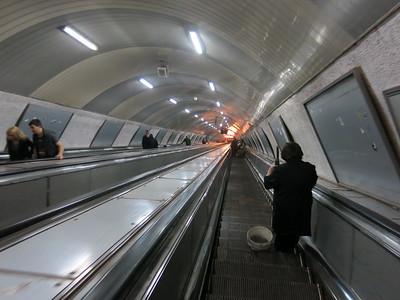 riding the escalator down to the metro