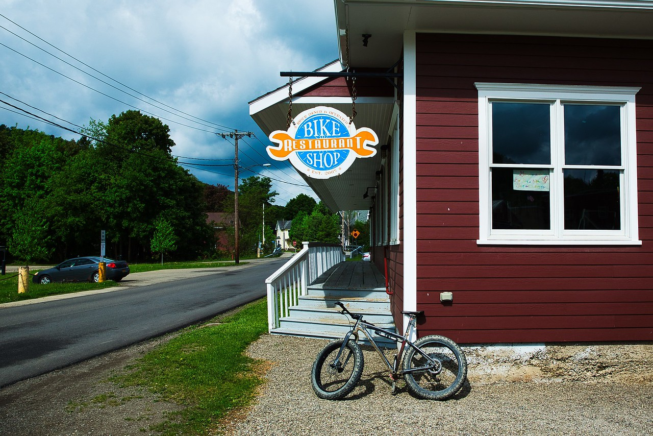 IMAGE: https://photos.smugmug.com/East-to-Ellicottville-2020/i-cRPHGhX/0/198a5f1e/X2/Bike%20Shop%20Restaurant-X2.jpg