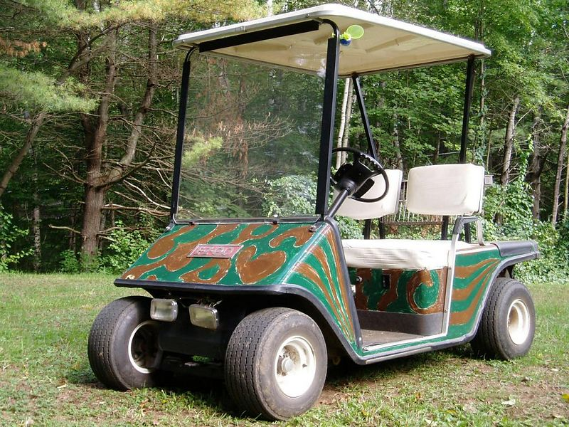 The camouflage golf cart, Steve's place.<BR>Fall 2003