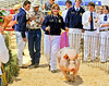 Shelby Meyer at auction with her Grand Champion Market Hog.