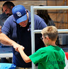 Frank Hilliker give a fist bump for encouragement at Eastern San Diego County Junior Fair.