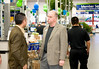 East County Chamber of Commerce Chairman of the Board Roger Roberts learns about Sam's Club from store manager Gustavo Molina. East County San Diego
