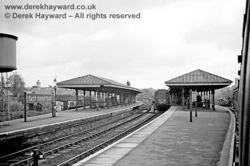 I am grateful to John Attfield for allowing me to use this image of East Grinstead High Level station, which was taken on 20 April 1965.  John's train is about to depart in the direction of Three Bridges, whilst a newly arrived DMU, complete with tail lamp, sits in the adjacent platform.  It is possible that this was bound for Tunbridge Wells.  Part of the water tower is just caught on the left.  John retains all rights to this image.