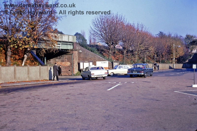 I am extremely grateful to Eric Kemp for allowing me to include some of his images on my site. Photographed on 9 November 1968 this is the bridge which  carried the road (Station Road) under the high level line.  The photographer is standing in the exit from the Low Level station forecourt and the blue car is heading into Railway Approach, and will shortly pass under a bridge which carried the line connecting the upper goods yard to the lower yard.  The wall in the previous photograph is on the left of the pedestrian nearest the camera.  Eric Kemp retains all rights to this image.