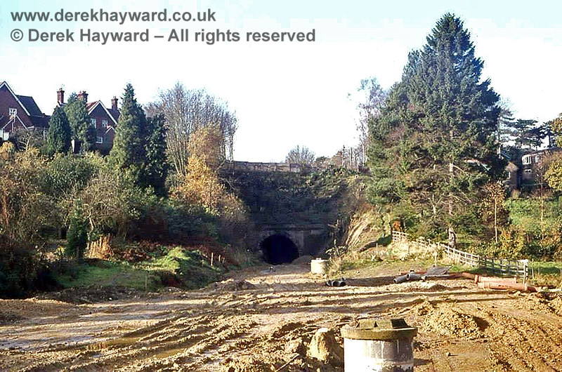 """East Grinstead No 1 tunnel (the one nearest to East Grinstead and 78 yards long) looking west. This tunnel was completely opened up and dug out during the construction of """"Beeching Way"""", the road that replaced the railway in this area. A bridge replaced it, to carry College Lane over Beeching Way, and no trace of the tunnel remains.    Image from the collection of the late Steve Blaikie.  Do you own this picture?  If so, please contact me."""