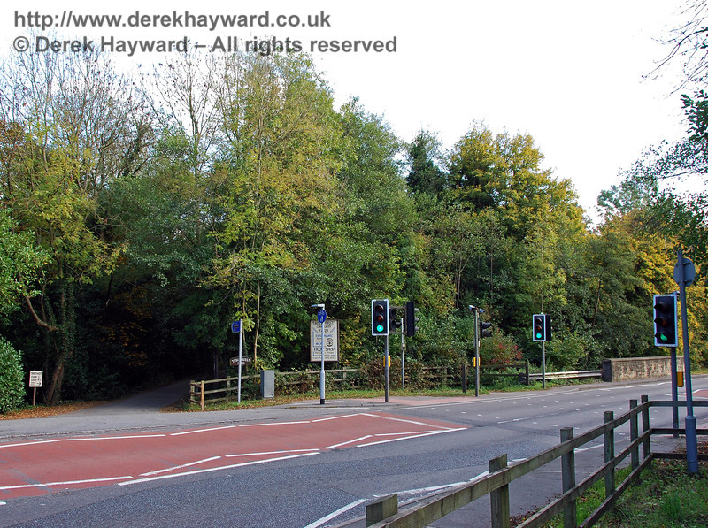 Looking east across the A22 towards the overgrown embankment that leads east towards Forest Row Station (behind the traffic lights). The road is very busy and this crossing is much needed. 18.10.2009