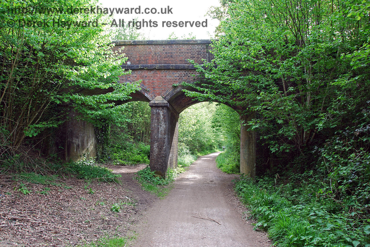 After leaving Hartfield Station the old trackbed crosses country heading west towards the site of the old Forest Row Station. However east of the station an old bridge survives carrying a private road and public footpath north towards Ashdown House School and some other nearby properties. This view looks west. 09.05.2009