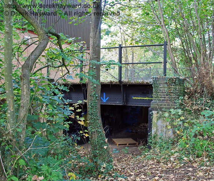 The bridge at the eastern end of Forest Row Station looking north.  There is virtually no headroom under the bridge and it's purpose is not clear. Information would be welcomed. 18.10.2009