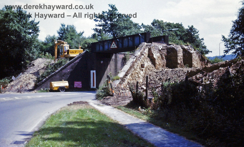 """The demolition of the railway bridge which stood to the west of Forest Row station in July 1973.  The sign says (rather obviously) """"Danger Demolition in Progress"""".  Eric Kemp retains all rights to this image."""