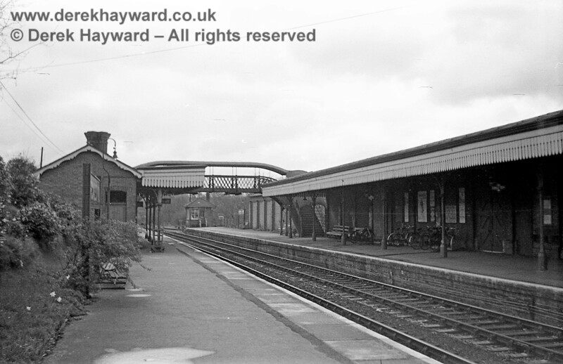 Looking east along the platform at Forest Row on 20 April 1965, with the signal box at the eastern end of the station.  Note the bikes in the racks on the other platform. John Attfield retains all rights to this image.