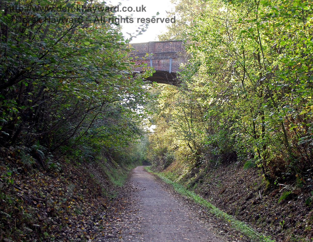 A little further down the track a high overbridge takes the B2028 over the old railway cutting.  This view looks west. 18.10.2009