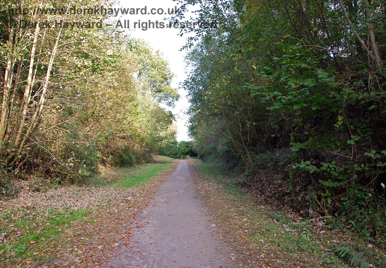 West of the site of Grange Road Station a footpath leads through Old Station Close and subsequently out into countryside that was landscaped after the railway closed.  There is no trace of the track bed left in this area. This view looks east up the footpath towards a gate leading to Old Station Close. 18.10.2009