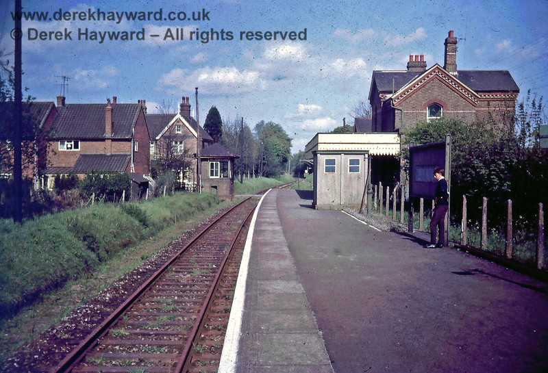 I am grateful to Nick Mander for allowing me to use this image of Grange Road station looking east along the platform in August 1967.  The line had closed in January 1967 but the signals remained in situ.  The signal box (with open window) stands on the left just in advance of the level crossing, although no eastbound starting signal appears to have been provided.  The Royal Oak Public House is on the left directly beyond the crossing.  In the far distance a westbound home signal can just be seen.  I hope the young man on the right was not waiting for a train...!!   Nick retains the copyright of this image.