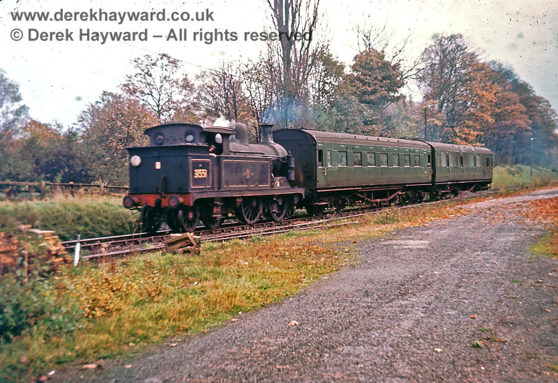 I am grateful to Nick Mander for allowing me to use this image which he acquired (by purchase) many years ago.  Unfortunately the identity of the  original photographer is unknown.   31551 passes the goods yard as it approaches Grange Road station with a westbound train.