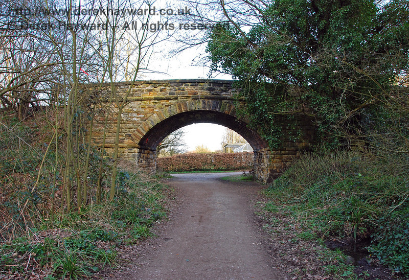 The reverse of the previous view, looking east under the road bridge towards Hartfield Station. Trains would have passed directly through the garden hedge. 22.03.2009