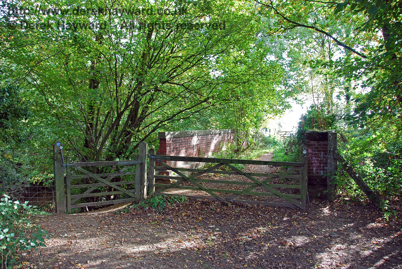There is a path up from the railway on to the bridge (the gate on the left) and this shot looks south across the bridge in the direction of Hartfield village. 18.10.2009