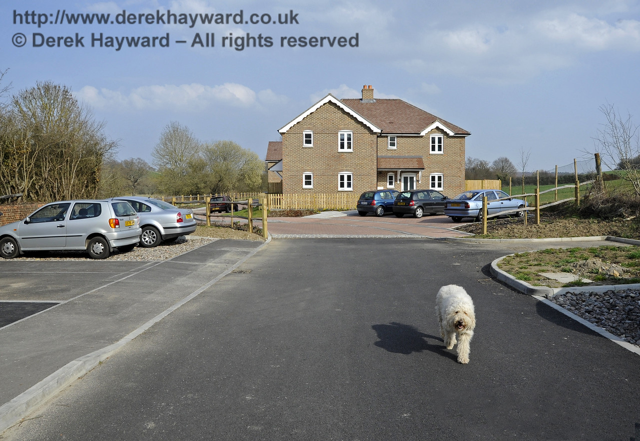 In 2011/2012 extensive development took place in Hartfield Station Goods Yard.  The new housing development at the eastern end of the Goods Yard, looking east. (The dog is an associate member of the Council....)  23.03.2012  3937