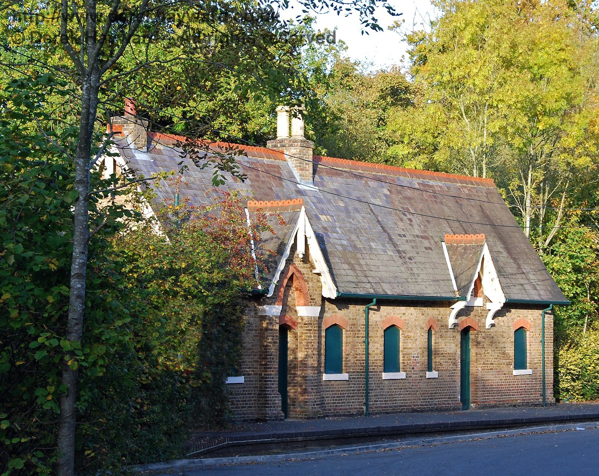 Rowfant Station pictured four years later in 2009, looking east. The site is little changed but the hedge has grown somewhat. The building is illuminated by the autumn sun. 18.10.2009