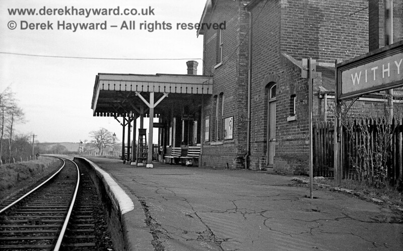 Withyham Station looking east from track level on 6 January 1966.  A westbound Home signal can be seen beyond the end of the platform and a set of steps stands ready for use, but otherwise all is quiet.  John Attfield retains all rights to this image.