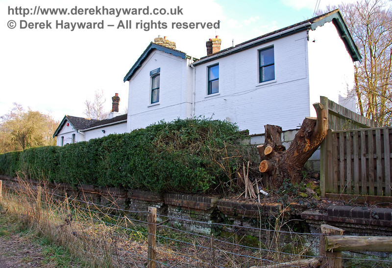 A later view of Withyham Station in 2009, looking east.  A small fence has been erected to keep walkers away from the edge of the old platform, and the route of the public footpath has been marginally adjusted.  It is unclear whether this is to protect private property or on safety grounds as some of the bricks are loose. 02.03.2009