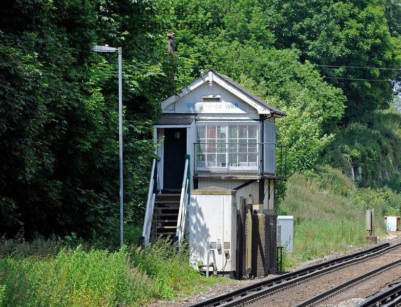 The former signal box at Shepherds Well (or Shepherdswell) Station, Network Rail.  The lamp in shot formerly lit the path provided for the signalman.  The sign on the box reads Shepherds Well, which is in accordance with most older maps of the railway.  17.06.2015  11381