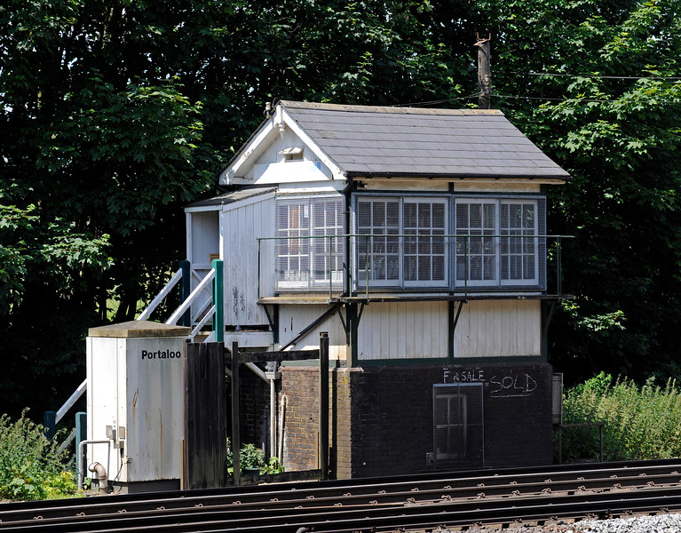 The former signal box at Shepherds Well (or Shepherdswell) Station, Network Rail, equipped with every possible convenience. The chalked signs indicate that the box has been acquired by the East Kent Railway.  There is now just the small matter of moving it....  17.06.2015  11365