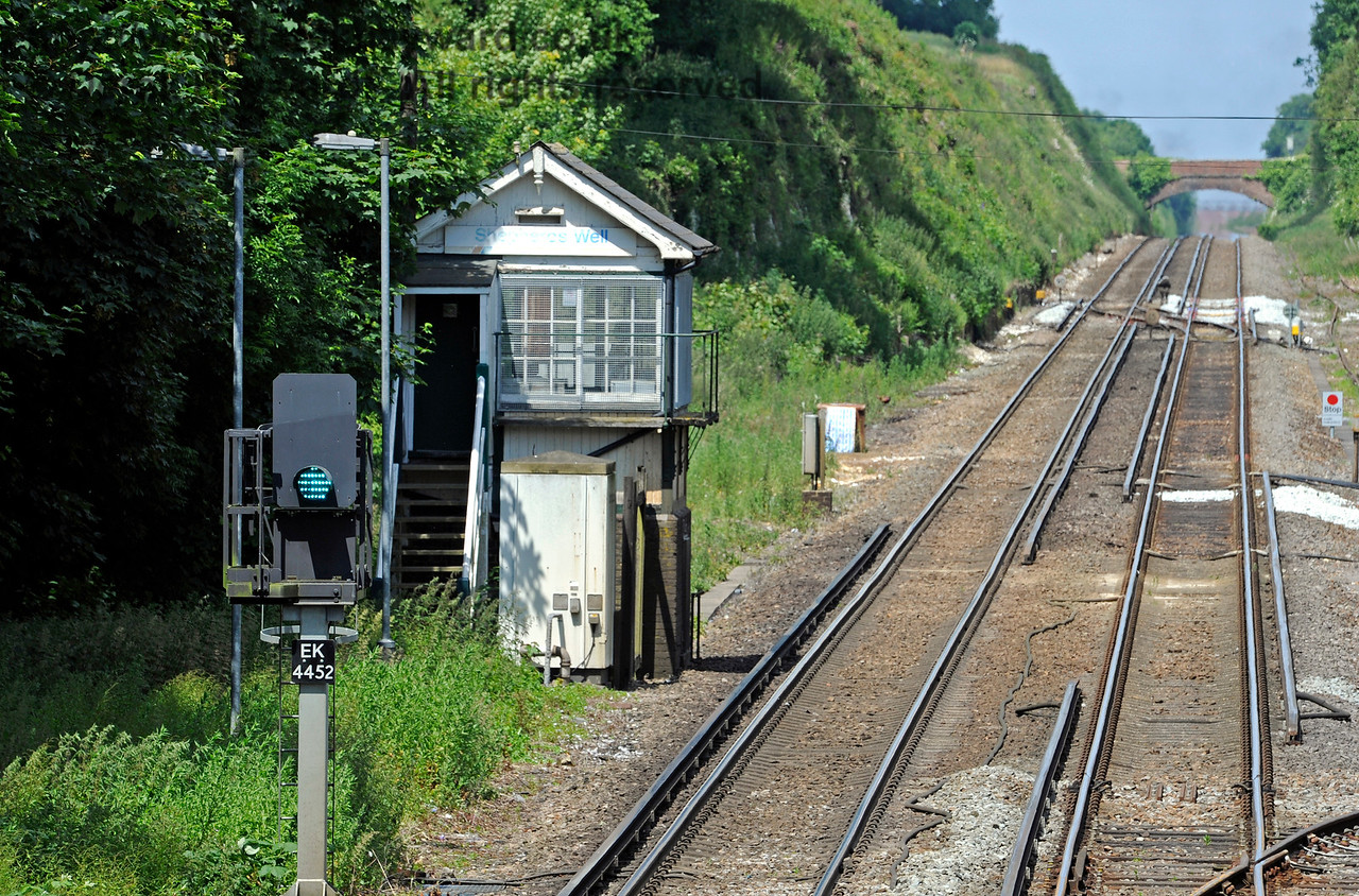 Old and new.  The former signal box at Shepherds Well (or Shepherdswell) Station, Network Rail, with the modern signal that has replaced it in the foreground. 17.06.2015  11378