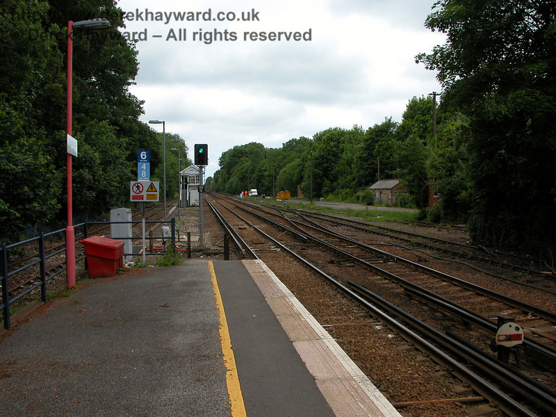 The plate on the signal reads SH12, indicating that in 2005 the signal was still controlled by the signal box at Shepherds Well (or Shepherdswell).  There is a closer view of the refuge siding on the left (since removed) and of the old style shunting signal on the right.  Note the short siding on the right leading towards the camera which probably originally served a loading dock.  06.06.2005