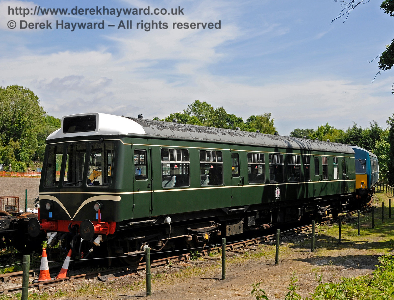 BR Class 108 DMU, coach M51922, in the sidings at Shepherdswell Station, East Kent Railway.   This unit (including coach M51562 - out of shot) belongs to the National Railway Museum at York, as an example of a coach that was never refurbished.  Before it's arrival at the EKR the unit was repainted into BR Green with Speed Whiskers.  It was loaned to the EKR in July 2014.  Shepherdswell Station, East Kent Railway.  17.06.2015  12717