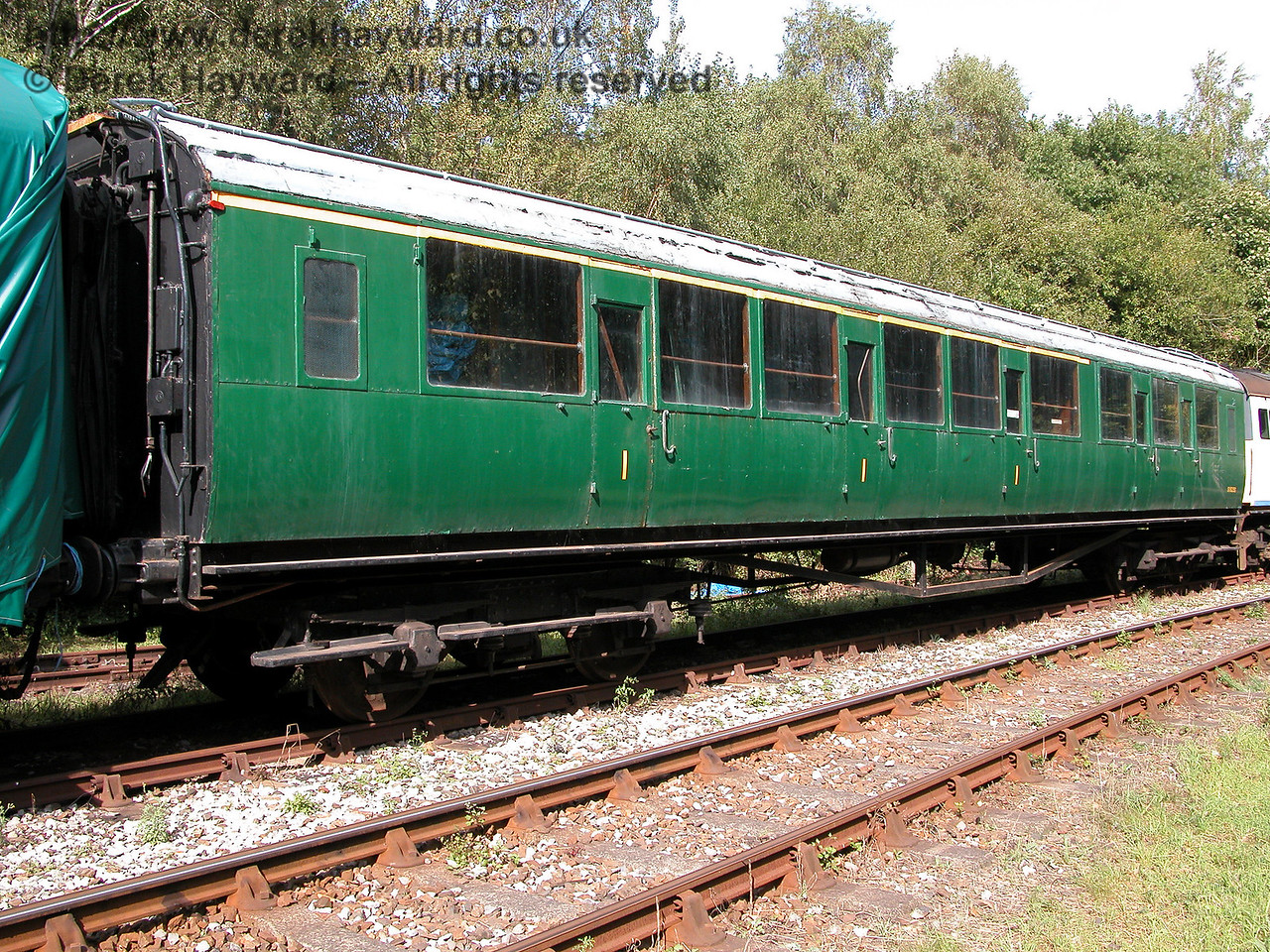 4-COR unit 3142, Trailer Composite 11825, stored at Shepherdswell on 19.09.2006.  During a visit in 2015 this coach had also been covered by a tarpaulin, and was therefore not photographed.