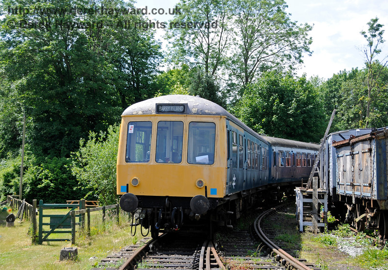 BR Class 108 DMU, coach M51562, in the sidings at Shepherdswell Station, East Kent Railway.  This unit (including coach M51922 - out of shot) belongs to the National Railway Museum at York, as an example of a coach that was never refurbished, and also the 1000th vehicle to be built at BR's Derby Workshops.  The unit was loaned to the EKR in July 2014.  Shepherdswell Station, East Kent Railway.  17.06.2015  12735