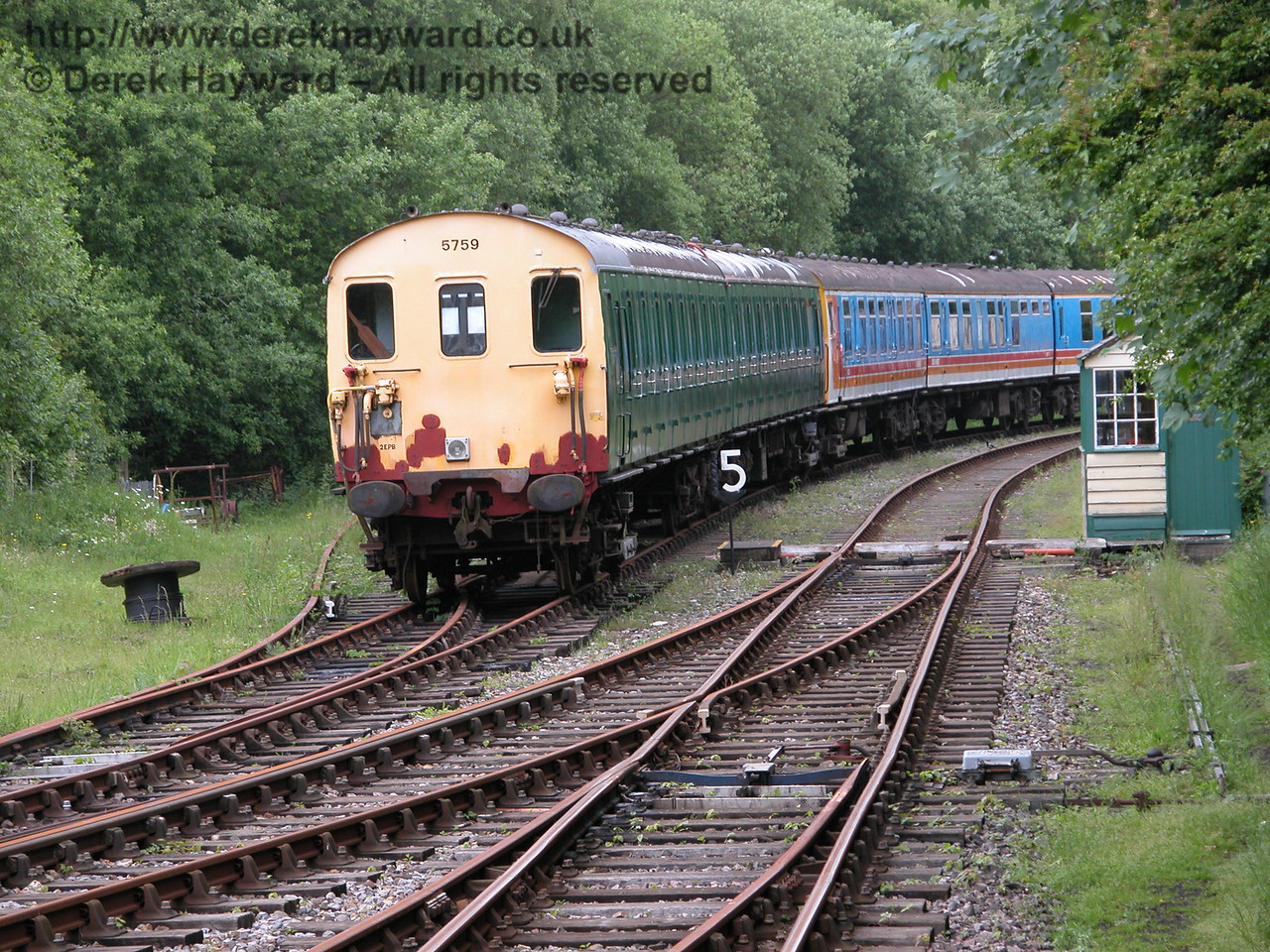 Shepherdswell sidings looking east in 2005. 2-EPB 5759 and 4-CEP 7105 (including a Buffet Car from 7014) are in shot. 06.06.2005