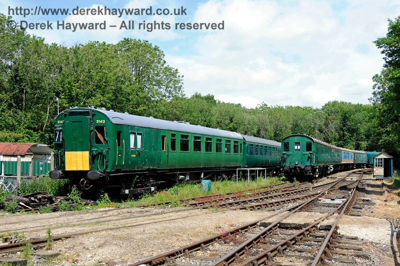 Looking east at stored stock from the platform at Shepherdswell Station, East Kent Railway.  17.06.2015  12732