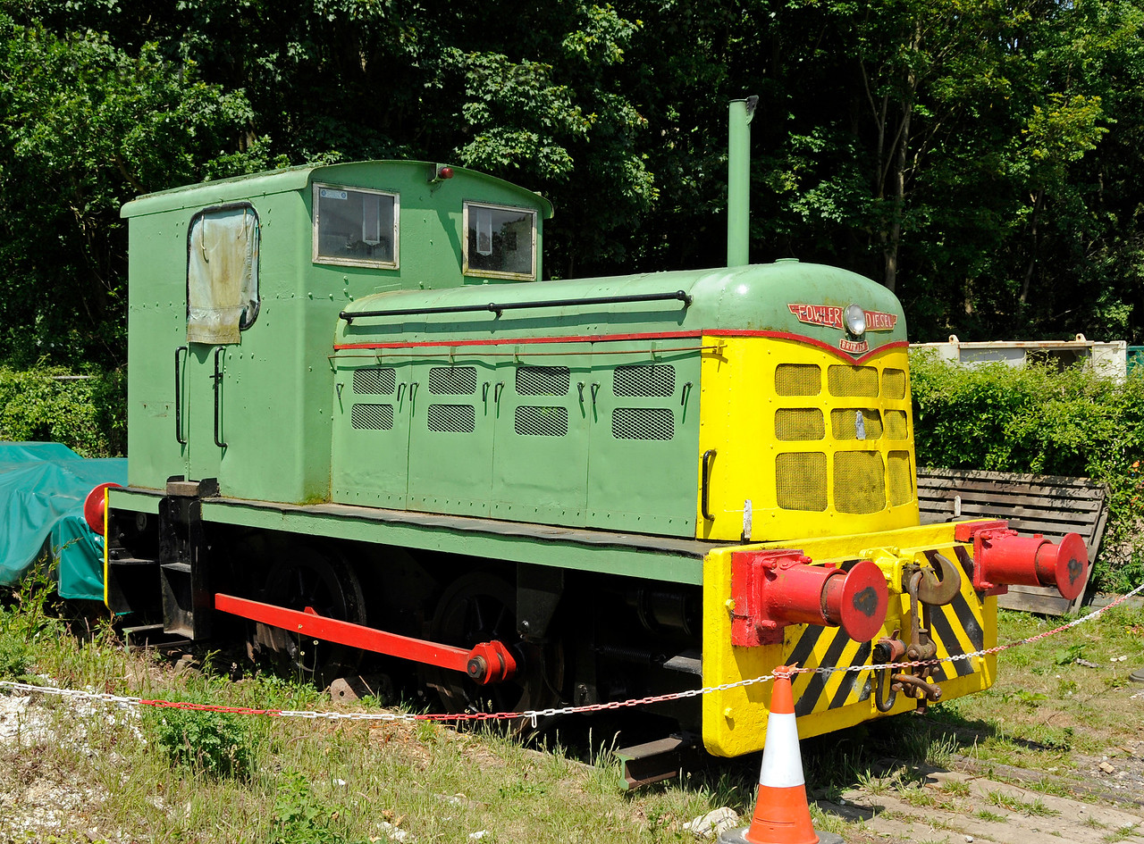 Fowler 0-4-0 Snowdown (works number 416002).  This engine worked at the nearby colliery at Snowdown as a yard shunter.  It is privately owned and currently has no train brakes.  The engine is seen stabled on the line that links to the adjacent Network Rail sidings which are north east of the Network Rail station.  This link is intact except for one short length of rail removed to isolate the line.  The EKR are hoping to reinstate the link and acquire the adjacent sidings.  Negotiations were taking place at the time this picture was taken.  Shepherdswell Station, East Kent Railway,  17.06.2015  12719  (See also photo below).