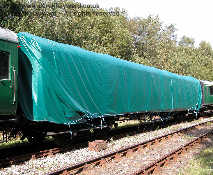 4-COR unit 3142, Trailer Third 10096, stored at Shepherdswell.  This coach is sheeted as the roof is not watertight. 19.09.2006  The coach remained in this state in 2015 and was not photographed again.