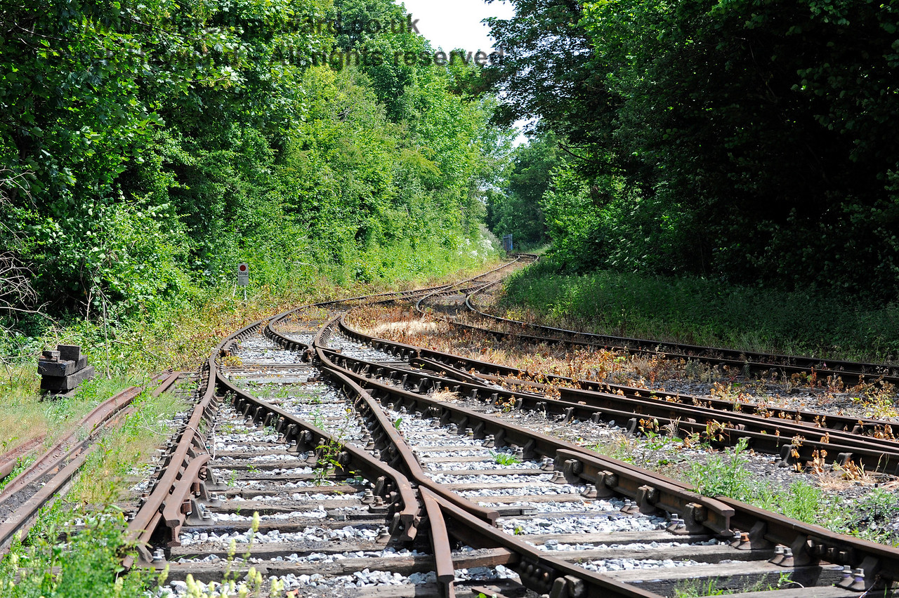 Looking east towards Eythorne.  The point directly in front of the camera will carry the additional track into the new carriage shed.  Shepherdswell Station, East Kent Railway. 17.06.2015  11370