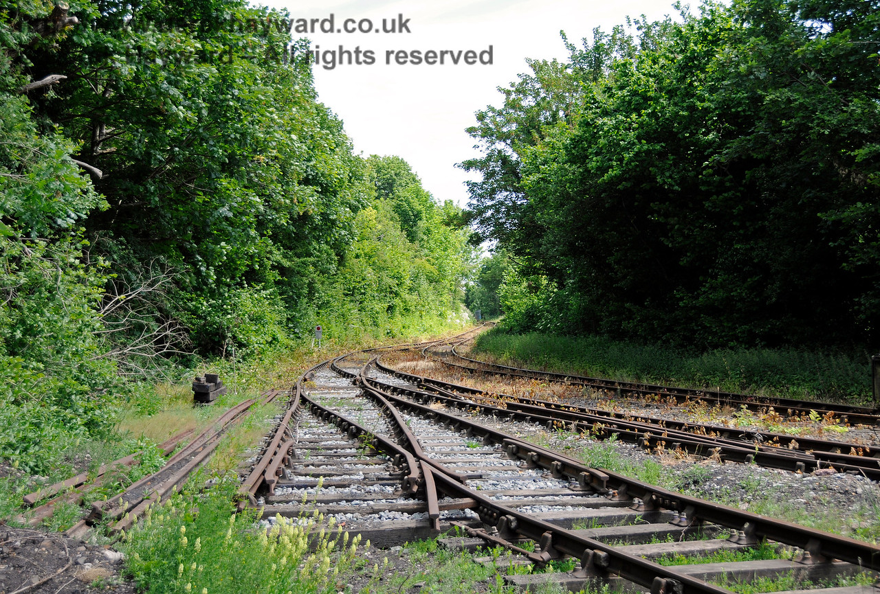 The reverse of the previous view, looking east towards Eythorne.  The point directly in front of the camera will carry the additional track into the new carriage shed.  Shepherdswell Station, East Kent Railway. 17.06.2015  12746