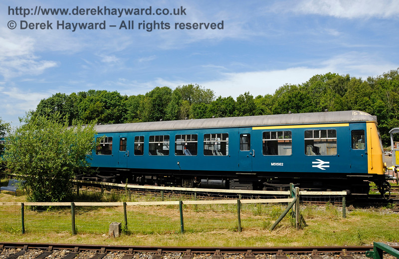 BR Class 108 DMU, coach M51562, in the sidings at Shepherdswell Station, East Kent Railway, and viewed from the station platform.  This unit (including coach M51922 - out of shot) belongs to the National Railway Museum at York, as an example of a coach that was never refurbished, and also the 1000th vehicle to be built at BR's Derby Workshops.  The unit was loaned to the EKR in July 2014.  17.06.2015  12728