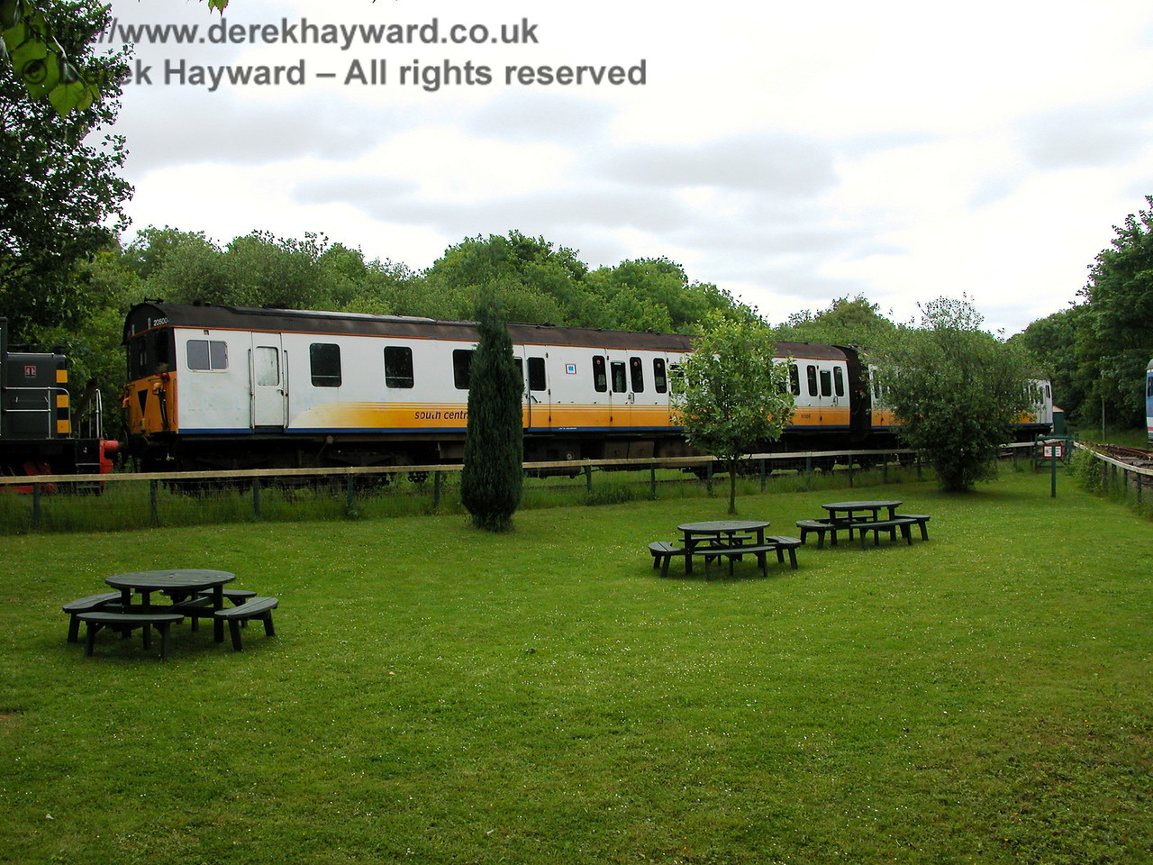 Shepherdswell sidings viewed across the picnic area in 2005.  Thumper 205001 is in the siding in South Central livery.  06.06.2005