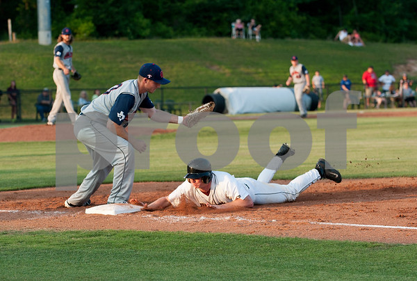 Tyler Moore is safe at first base during the East Texas Pump Jacks' first home game Thursday June 4, 2015 at Irwin Field n the campus of The University of Texas at Tyler in Tyler, Texas. They played against the Acadiana Cane Cutters and will face them again Friday night. They play Brazos Valley Bombers Saturday and Sunday at Irwin Field. The Pump Jacks, a Texas Collegiate Wooden Bat League, are playing their first season in Tyler after moving from nearby Kilgore.   (photo by Sarah A. Miller/Tyler Morning Telegraph)